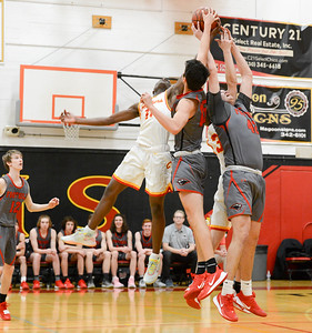 Chico's Marvelous Owens (left) battles Foothill's Bekdoo Lewis (middle) and Brandon McCracken (right) for a rebound Tuesday at The Pit. (Matt Bates -- Enterprise-Record)