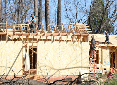 A construction crew works on a house off of Pearson Road on Wednesday in Paradise. (Matt Bates -- Enterprise-Record)