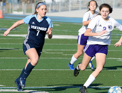 Pleasant Valley's Rylee Jellison (left) and Shasta's Abigail Moore (right) sprint toward a loose ball during then Northern Section Division I semifinal at Asgard Yard. (Matt Bates -- Enterprise- Record)