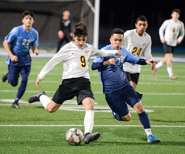 Chico's Jan Zaragoza (left) tries to get off a pass before Pleasant Valley's Tony Martinez (right) can get to the ball during the Northern Section Division I semifinal game Tuesday at Asgard Yard. (Matt Bates -- Enterprise-Record)