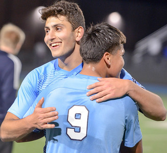 Pleasant Valley's Andy Khalil (left) smiles as he embraces teammate Saith Torres (9) the Vikings defeated Chico 2-0 Tuesday night at Asgard Yard. (Matt Bates -- Enterprise- Record)