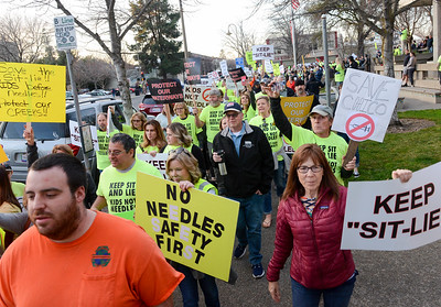 Hundred of protesters march Tuesday outside the Chico City Council Chambers in Chico. (Matt Bates -- Enterprise-Record)