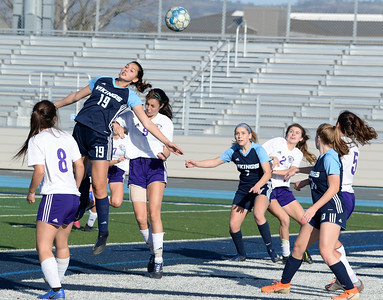 Pleasant Valley's Sofia Maldonado (19) leaps over Shasta's Isabelle Tate-Arevalo (8) while attempting to head a corner kick during the Northern Section Division I semifinal Tuesday at Asgard Yard. (Matt Bates -- Enterprise- Record)