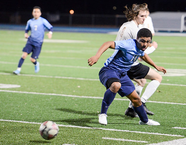 Pleasant Valley's Dante Jackson (14) shields Chico's Kellen Leigh (8) from the ball during the Northern Section Division I semifinal game Tuesday as Asgard Yard. (Matt Bates -- Enterprise- Record)