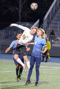 Chico's Fleet Irvine (left) tries to leap above Pleasant Valley's Tanner Weast (right) for a header during the Northern Section Division I semifinal game Tuesday at Asgard Yard. (Matt Bates -- Enterprise-Record)