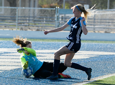 Pleasant Valley's Anna Converse (right) collides with Shasta goalkeeper Avery Harbour (left) during Tuesday's Northern Section Division I semifinal at Asgard Yard. (Matt Bates -- Enterprise- Record)