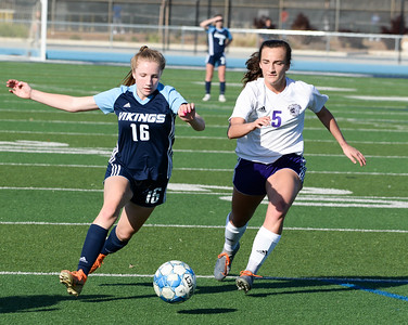 Pleasant Valley's Faylinn Berkowitz (left) looks to get by Shasta's Mia Fleming (right) during the Northern Section Division I semifinal Tuesday at Asgard Yard. (Matt Bates -- Enterprise- Record)