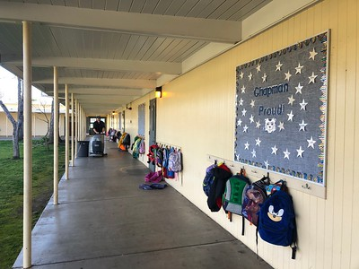 Dave Tehan cleans the hallways at Chapman Elementary School in Chico, where students hang their backpacks outside their classrooms, Tuesday, Feb. 4, 2020. (Natalie Hanson -- Enterprise-Record)