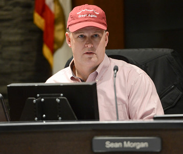 "Chico Councilor Sean Morgan wears a ""Make Northwest Chico Great Agian"" hat during a council meeting Tuesday in Chico. (Matt Bates -- Enterprise-Record)"