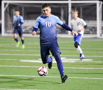 Pleasant Valley's Andy Khalil dribbles upfield during a home match against University Prep of Redding on Thursday, December 19, 2019, in Chico, Califronia. (Matt Bates -- Enterprise-Record)