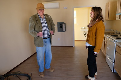Ron Reed, left, and Mia Kirk, of Base Camp Village, discuss their housing project for people disabled by mental illness and experiencing homelessness in Oroville on Monday. (Camille von Kaenel -- Mercury-Register)