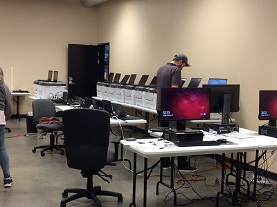 A computer tech at Butte County elections office in Oroville checks out the ballots on demand and touch-screen computers that will be used at the voter assistance centers later in the month. (Laura Urseny -- Enterprise-Record)