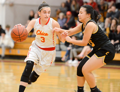 Chico's Nakhia Clements (left) tries to get by Jasmine Saephan (right) on Tuesday at The Pit. (Matt Bates -- Enterprise-Record)