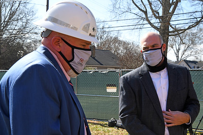 Mayor Rusty Knox talks with Town Manager Jamie Justice following the formal, socially distant groundbreaking ceremony for the historic 251 South Street school building.