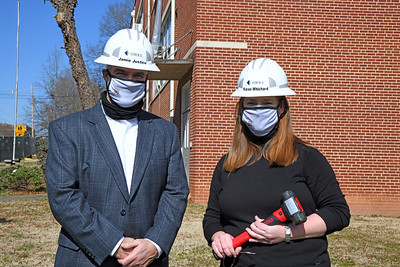 """Davidson Town Manager Jamie Justice and Assistant Town Manager Karen Whichard at the """"groundbreaking"""" ceremony for the 251 South Street project."""