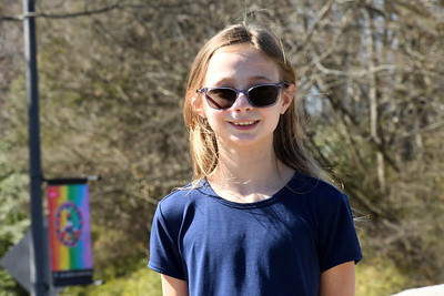 Artist Allison Szostek was all smiles to see her banner placed along Griffith Street at the west end of the bridge at Roosevelt Wilson Park. [NOTE: photo taken with a telephoto lens from roughly 30 feet away from the artist - who briefly removed her mask for the photo.]