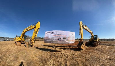 The sign held in between the two pieces of heavy equipment on the site in Dec. 2019.