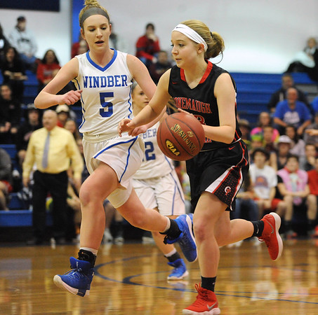 Windber's Alayna Elliot, left, pursues Conemaugh Township's Kassidy Wilson during a PIAA District 5, Class AA playoff game in Windber, PA., Friday, Feb.23, 2018. Windber won 54-32.