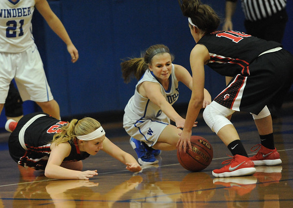 Windber's Madison Leonardis, center, fights for a loose ball with Conemaugh Township's Kassidy Wilson, left, and Olivia Roman during a PIAA District 5, Class AA playoff game in Windber, PA., Friday, Feb.23, 2018. Windber won 54-32.