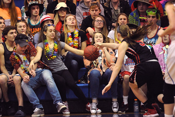 Conemaugh Township fans react as their team's Haley Curry, right, chases a loose ball into the stands during a PIAA District 5, Class AA playoff game against Windber, in Windber, PA., Friday, Feb.23, 2018. Windber won 54-32.