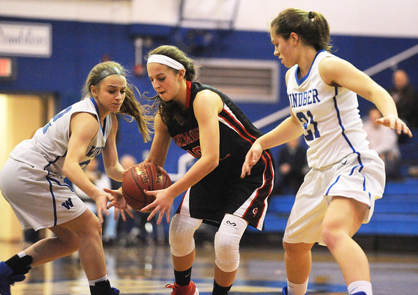 Conemaugh Township's Olivia Roman, center, fights for a loose ball with Windber's Madison Leonardis, left, and Jackie Toki during a PIAA District 5, Class AA playoff game in Windber, PA., Friday, Feb.23, 2018. Windber won 54-32.