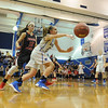 Windber's Madison Leonardis, right, passes to a teammate while pursued by Conemaugh Township's Olivia Roman during a PIAA District 5, Class AA playoff game in Windber, PA., Friday, Feb.23, 2018. Windber won 54-32.