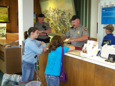 Anna and Abigail get junior ranger badge at Little Big Horn National Monument during Yellowstone Vacation.
