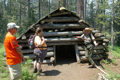 Day 2 - This morning we went on a wildflower hike with a park ranger.  He helped us find and name 42 different kinds of wildflowers.    The hike took us to a place called McGurk's meadow. This forest ranger is explaining to us how Mr. McGurk had to leave the cabin he built because didn't really own the property he built it on.  He built the cabin 150 years ago and it is still standing strong.
