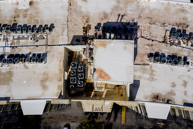 Aerial photo overhead shot HVAC rooftop compressor units inspection