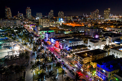 Colorful neon lights Miami Beach Ocean Drive aerial view