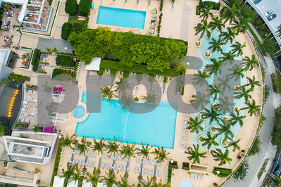 Aerial image of a pool deck with palm trees