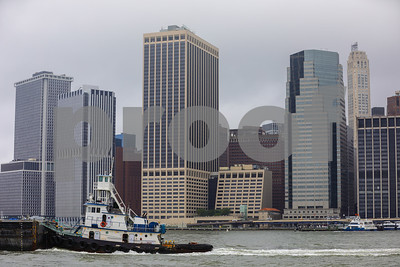 Tugboat in the river with Manhattan NYC in the background