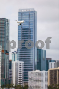 Image of a drone in action with city in background