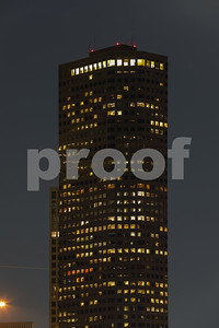 Night photo of a building illuminated at night with office lights on inside