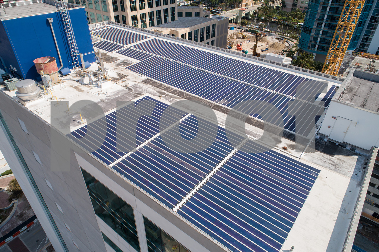Aerial image solar power building rooftop roof panels
