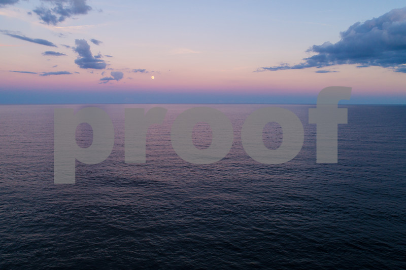 Aerial image moon over the ocean
