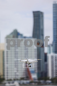 Drone hovering with a city in the background