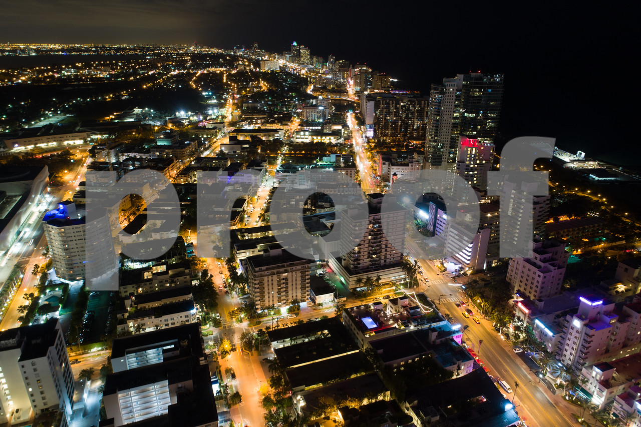 Aerial night Miami Beach Collins Avenue