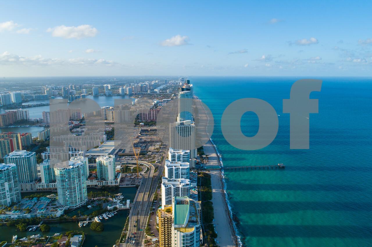 Aerial above coastal city Sunny Isles Beach FL