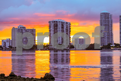 Beautiful sunset with waterfront condominiums