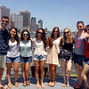 With Manhattan as their backdrop, a group of fellows pose on the ferry to Governor's Island.