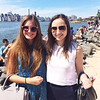 Jorie McLeod and Andreea Arama soak up some sun on the bank of the Hudson at Smorgasburg, a flea and food market, in Brooklyn.