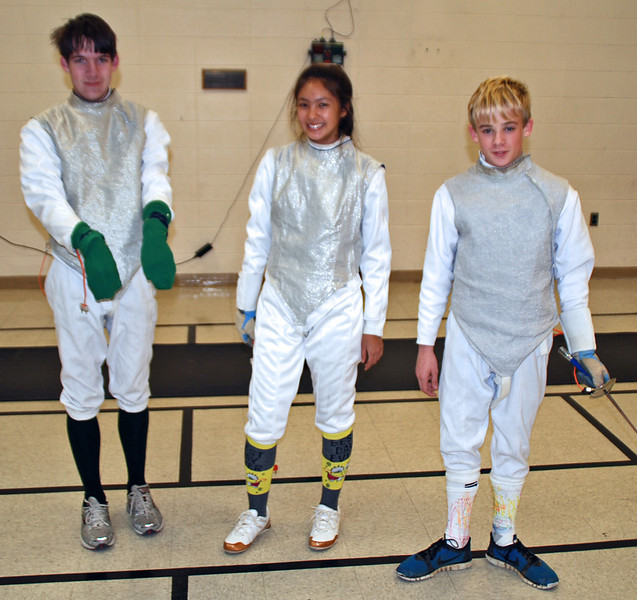 Entries in the 2011 CCFC Halloween Sock Contest (Foil).  From left: George LaPorte, Natasha Turkmani and Grant Anderson.