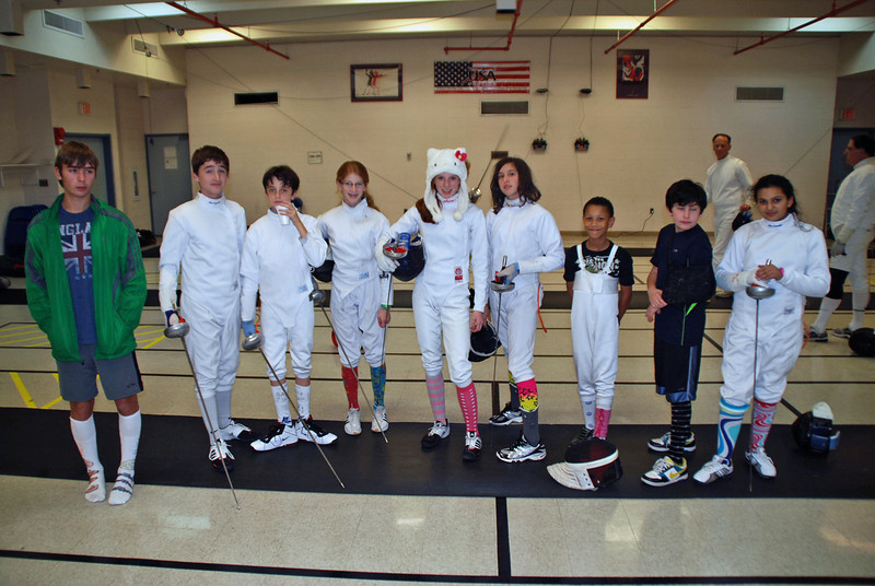 Entries in the 2011 CCFC Halloween Sock Contest (Epee).  From left: Sam Hayden, Alex Cohen, Romain Hufbauer, Alexis Sandler, Juliana Bain, Julia Smith, Bryce Knight, Levi Freedman, and India Bhalla-Ladd.