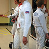 Marine Edward Hill referees at the Chevy Chase Fencing Club.
