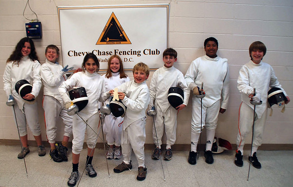Flat Stanley visited the Chevy Chase Fencing Club on October 21, 2008.  From left, back row: Katherine Surko, Raphael Hviding, Annabel Coke, Alex Cohen, Seth Flanagan, Jacob Roberts. Front row, holding Flat Stanley, Elizabeth Wiggins and Carter Tate.