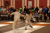 The fencer from Kuwait attacks.