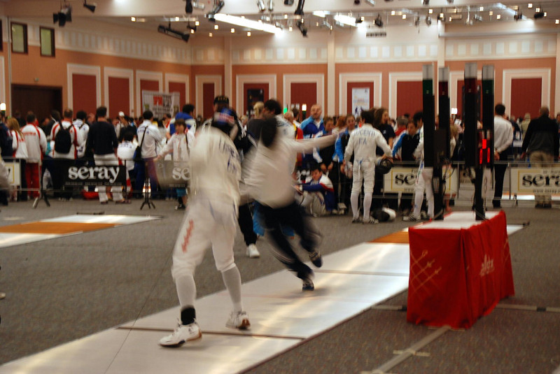 James Kaull fleche in warm-up before Cadet Men's Epee Prelims.
