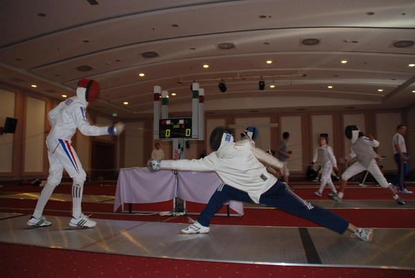 Practice session the day before the Cadet Men's Epee.  Josh Dolezal (right) against a French fencer.