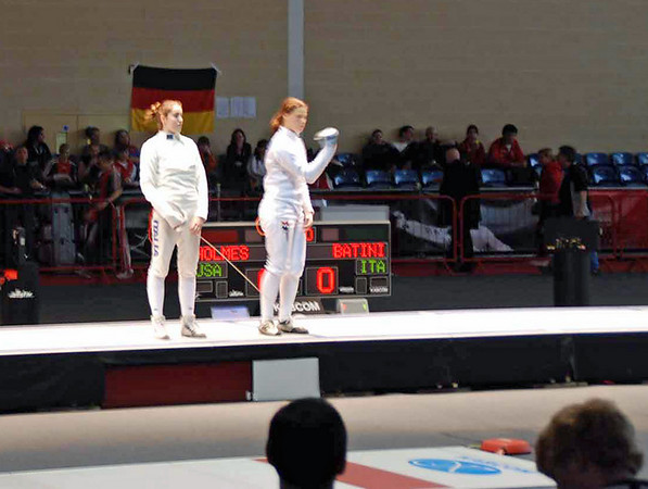 """Katharine salutes the audience.  She goes against Camilla Batini, Italy.  <P></P><div id =""""my_music"""">  </div>"""